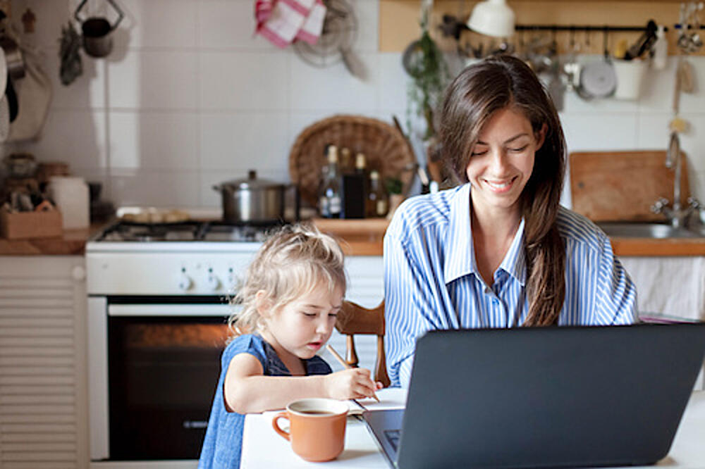 woman working at home with child